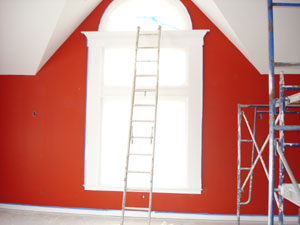 How to Paint New Woodwork - picture of construction site painting a window